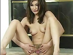 Sexy whore Jade Hsu inserting a toy deep in her sweet twat