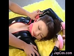 Japanese babe in latex suit with nice tits