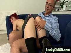Shorthaired redhead fucked and spanked by older guy