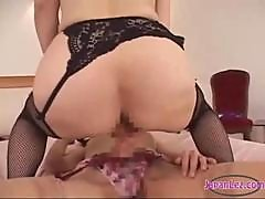 Asian Woman In Stockings Getting Her Pussy Fucked With Strapon By Other Woman On The Bed In The Bedroom