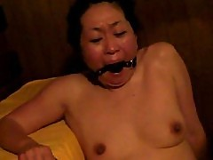 Japanese slave in sauna gets fingered